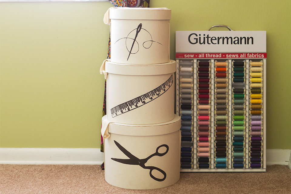 Stacked hat boxes are great for storing craft supplies.