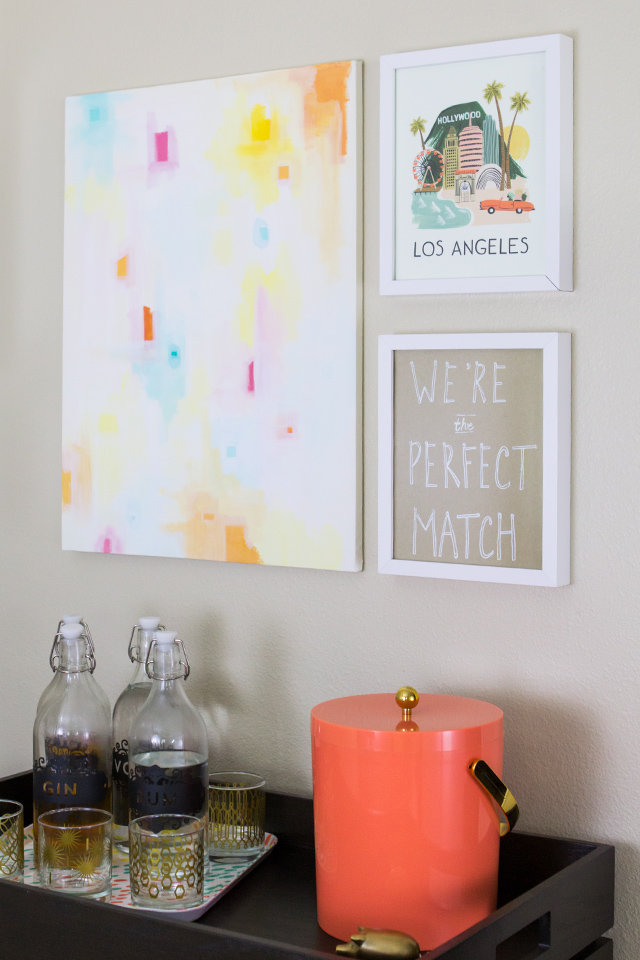 Hang a group of art prints and original art over a wine or bar cart to create a stylish spot on your home.