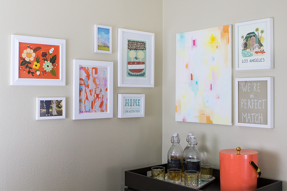 Make a cozy nook in your home by creating a gallery wall in a corner.