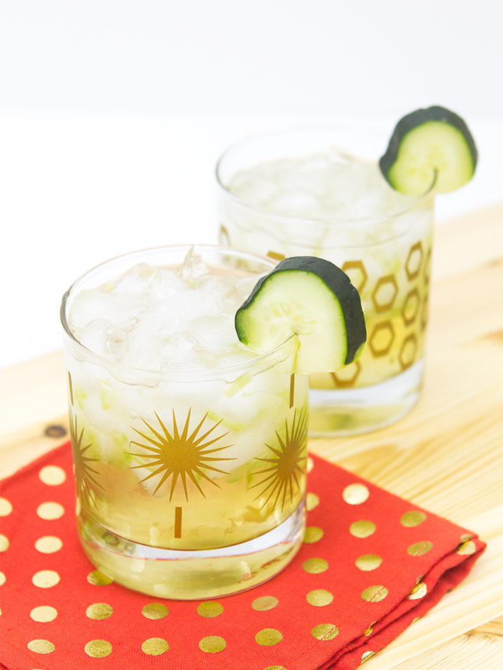Mix up this refreshing summer cucumber cocktail! Muddled cucumbers and limes are topped with gin, St. Germain, coconut rum, pineapple juice and tonic water.