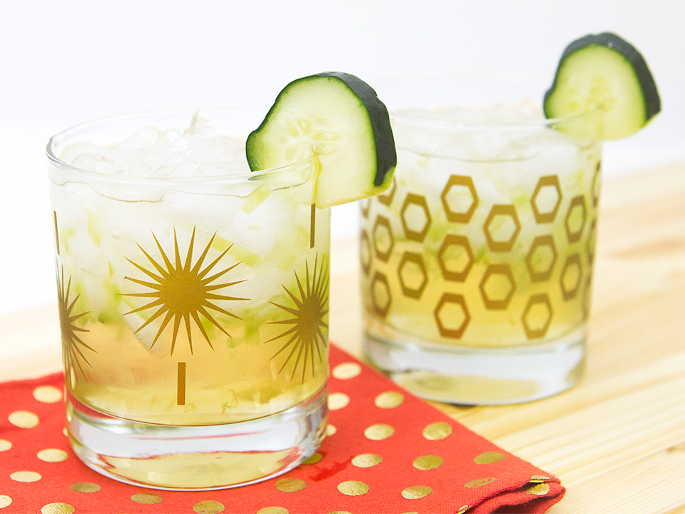 Muddled cucumbers and limes are topped with gin, St. Germain, coconut rum, pineapple juice and tonic water to make a a refreshing cocktail.