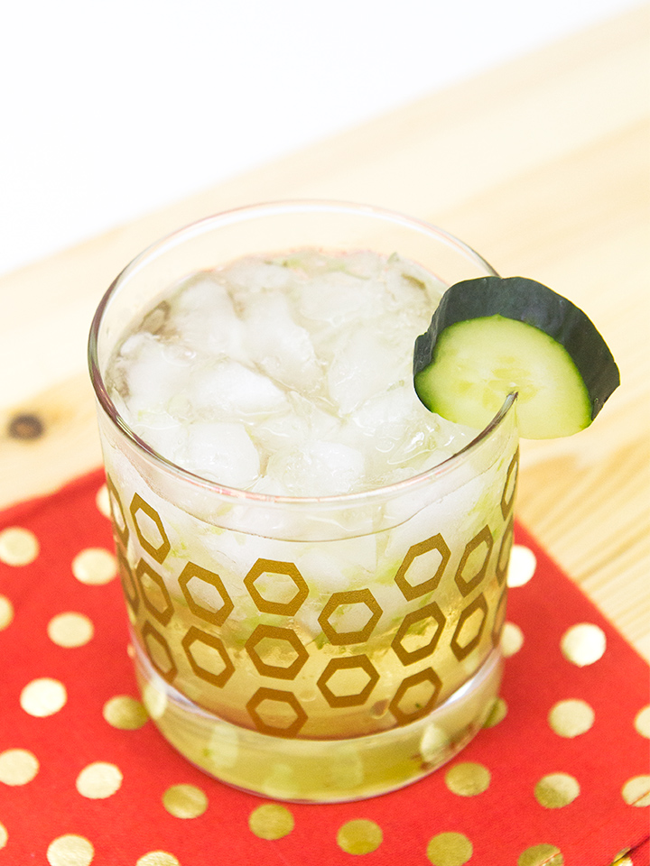 This cucumber cocktail is summer in a glass! Muddled limes and cucumber get topped with St. Germain, gin, coconut rum, and tonic water for a refreshingly cool cocktail.