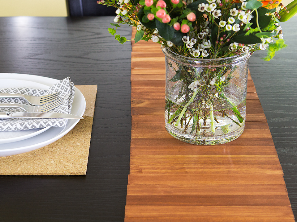 Update the look for your dining table with a DIY table runner made out of paint stir sticks.