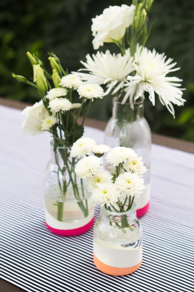 These DIY vases look paint dipped but they're not! Learn how to use balloons to create a similar look without the mess.