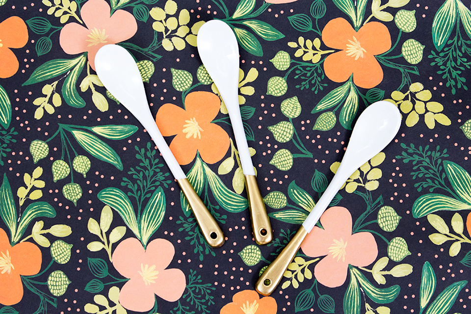 Rather than buy, DIY! These chic gold dipped spoons are less than $14 to make and are perfect for serving sauces and even salt.