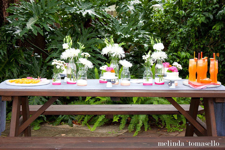 You don't need to spend a ton to host a stylish summer party! Get some inspiration from this gorgeous pink and orange backyard party.