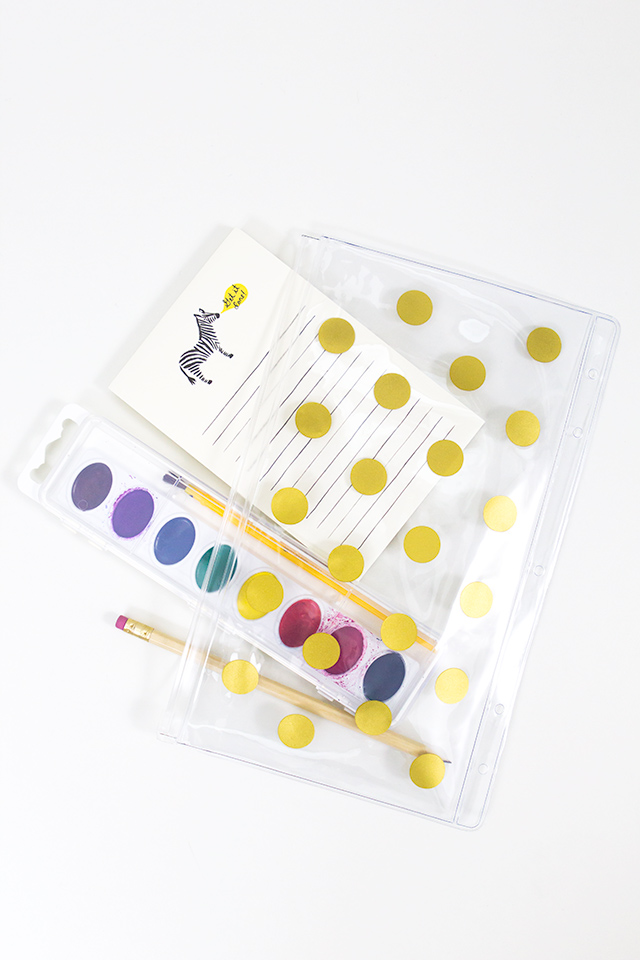 Spruce up a cheap vinyl pencil case with some gold vinyl polka dots! Click through for pattern.
