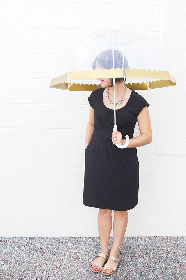 Cute and functional! This simple DIY project transforms a plain bubble umbrella with some adhesive gold vinyl.