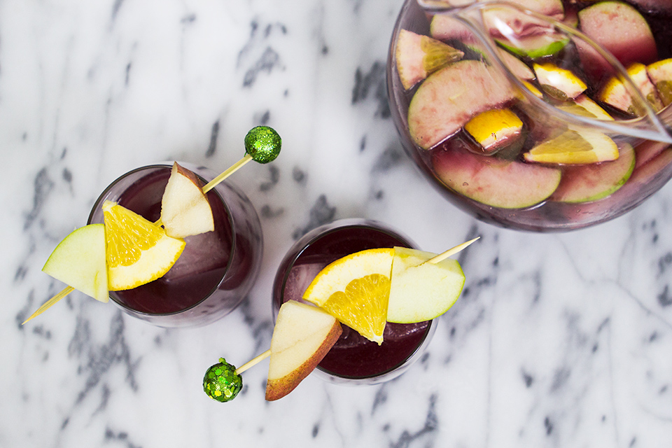 Serve up this holiday sangria with skewers tops with glitter ornaments. So festive and so delicious!