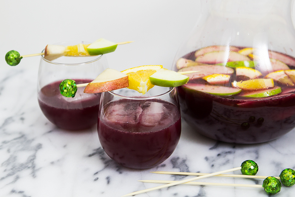 Your guests will love this Christmas version of sangria. It uses fresh citrus, pears and cinnamon syrup for a delicious and easy cocktail.