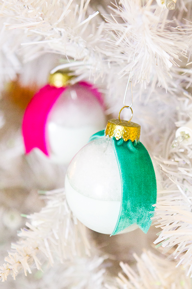 Sarah Hearts's paint dipped ornaments are filled with faux snow for added texture. The metal tops are made gold with a quick coat of a gold Sharpie paint pen.