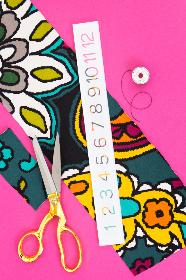 Love the colors in this fabric! This tutorial shows you how to use knit fabric scraps to make a cute headband.