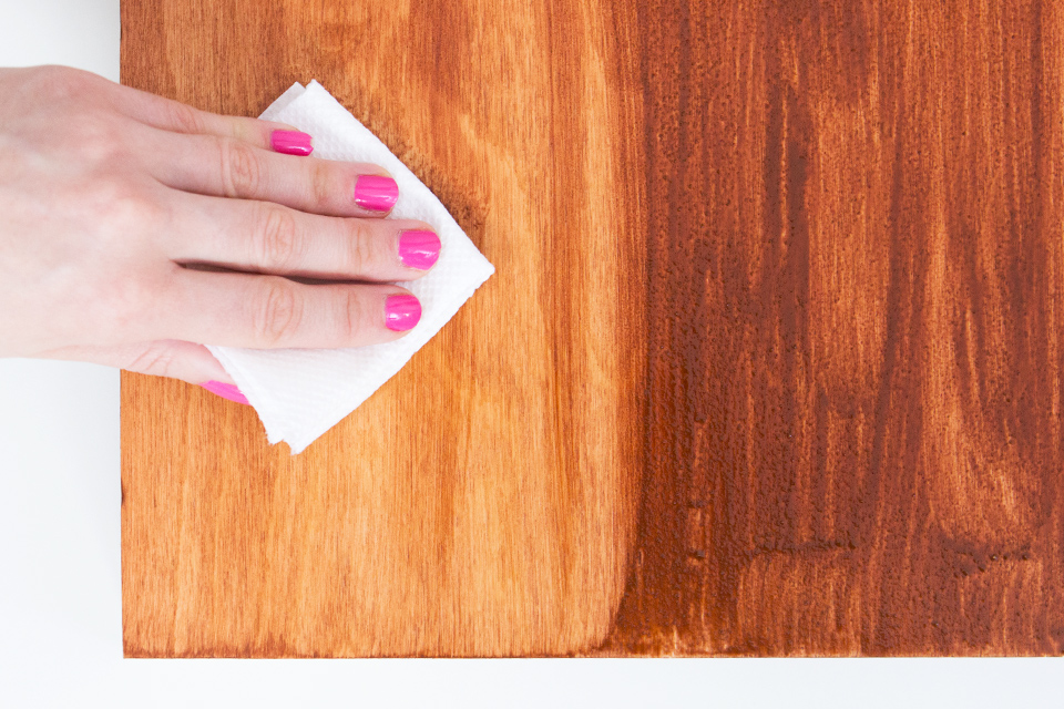 Apply wood stain with a brush and wipe it off using a paper towel. Easy way to create wall art that matches your home!