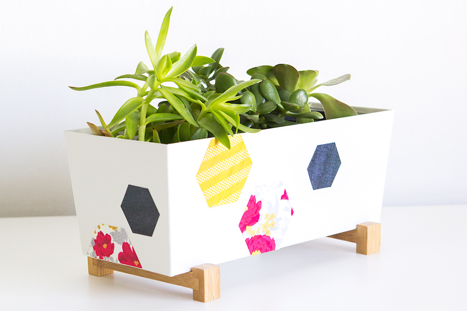 Loving this simple modern planter with colorful geometric shapes on it!