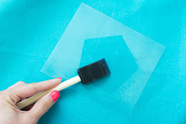 Apply foil adhesive inside a stencil to create pretty geometric shapes for gold foil to stick to! (Click through for the full tutorial)