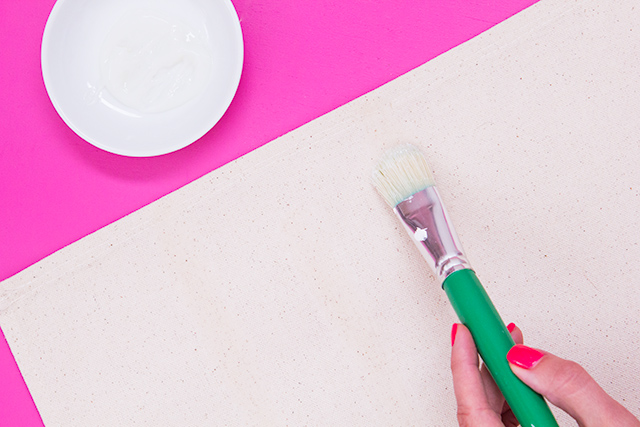 Paint foil adhesive with a large brush to create a simple abstract pattern.