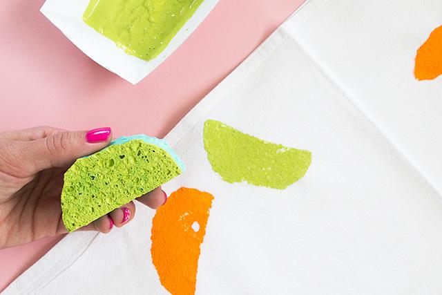 A plain dish sponge becomes a citrus stamp when it's cut into a moon shape.