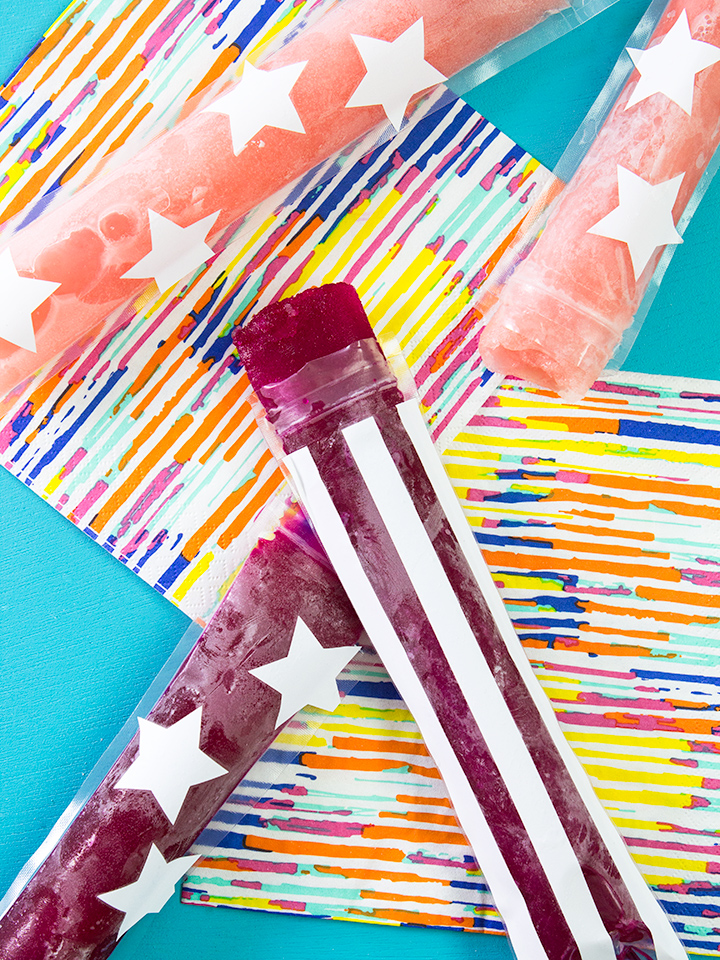 These homemade freezer pops are easy to make! Pour your favorite juices into decorated pop bags. So perfect for a 4th of July party!