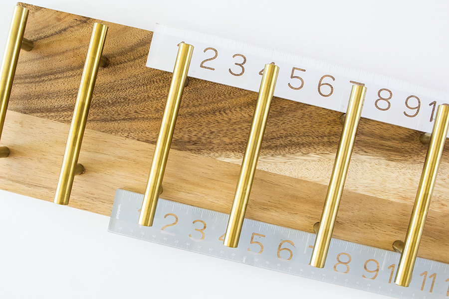Add drawer pulls to a cheese board to transform it into a taco stand.