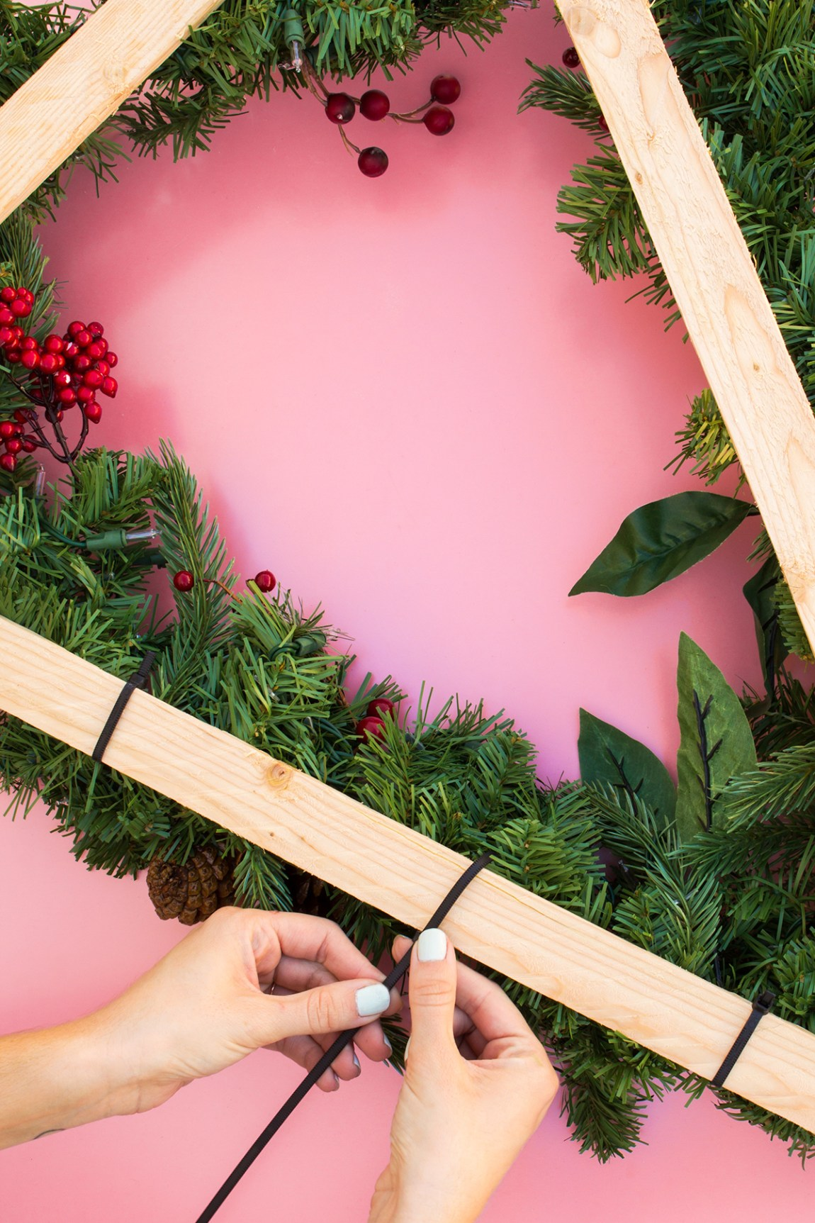 Learn how to create a tree shaped wreath that's perfect for decorating your front door this holiday season!