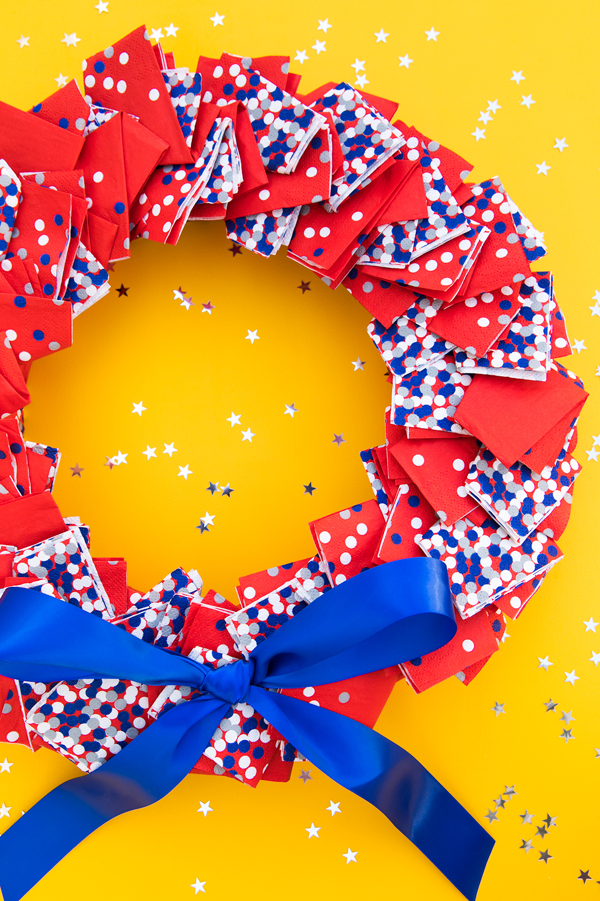 Use printed paper napkins to create a festive red white and blue wreath for the 4th of July! (Click through to watch the video tutorial)