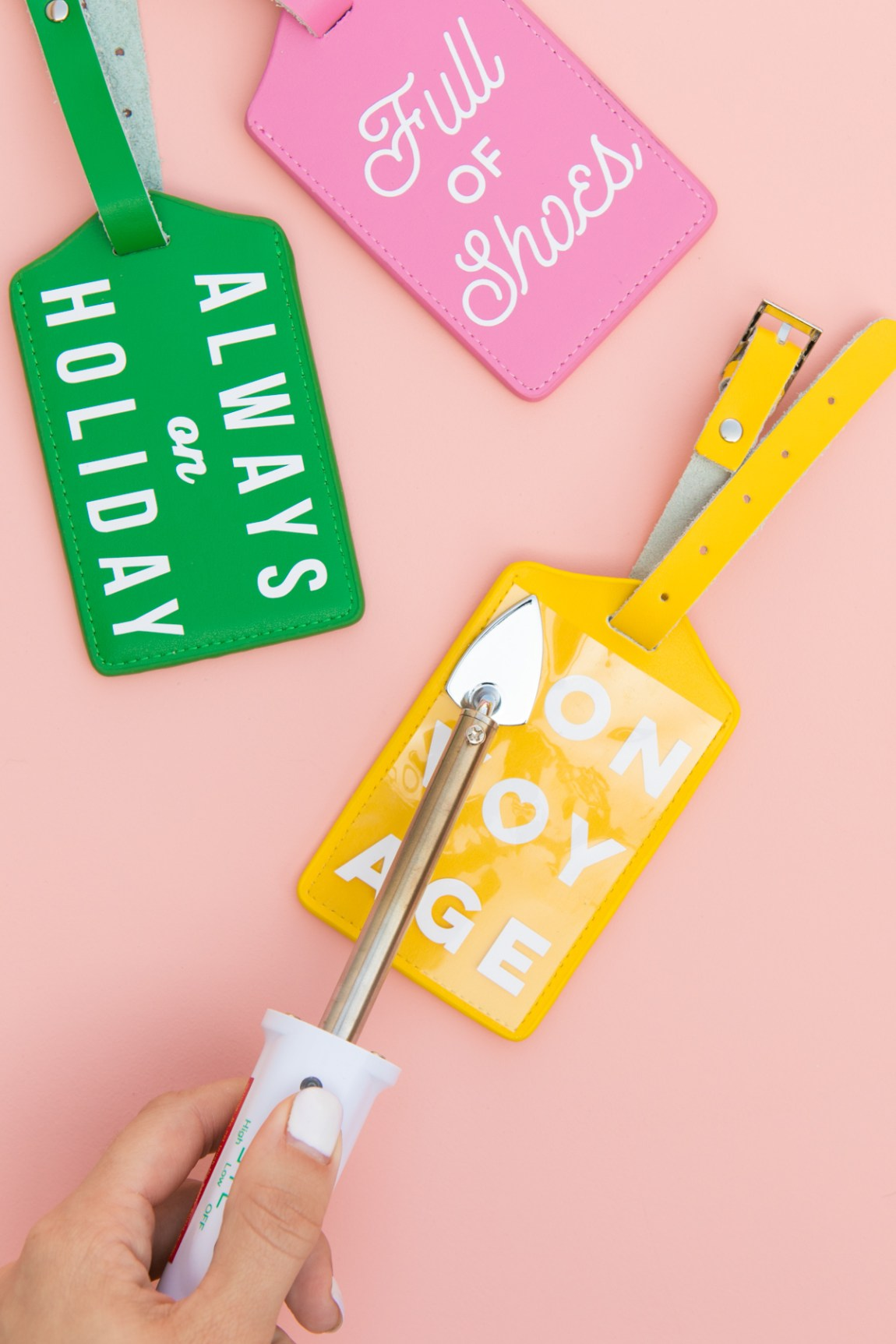 Use a mini iron to apply heat transfer vinyl to leather objects such as luggage tags.