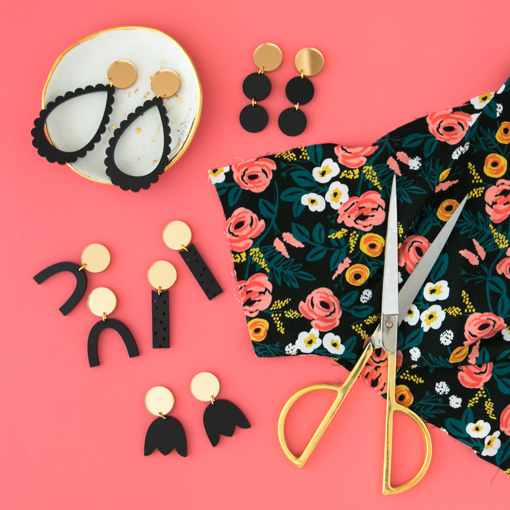 Black and gold laser cut acrylic earrings flatlay