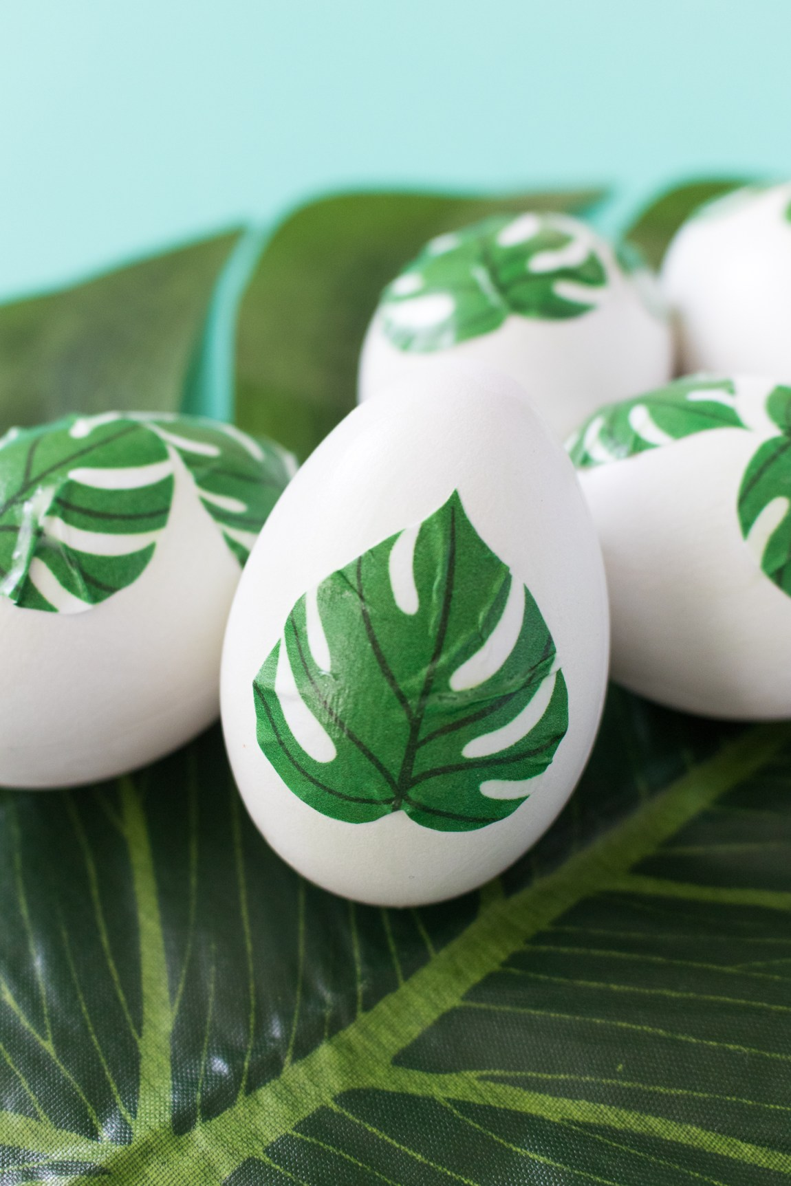 Close up of tropical leaf easter eggs