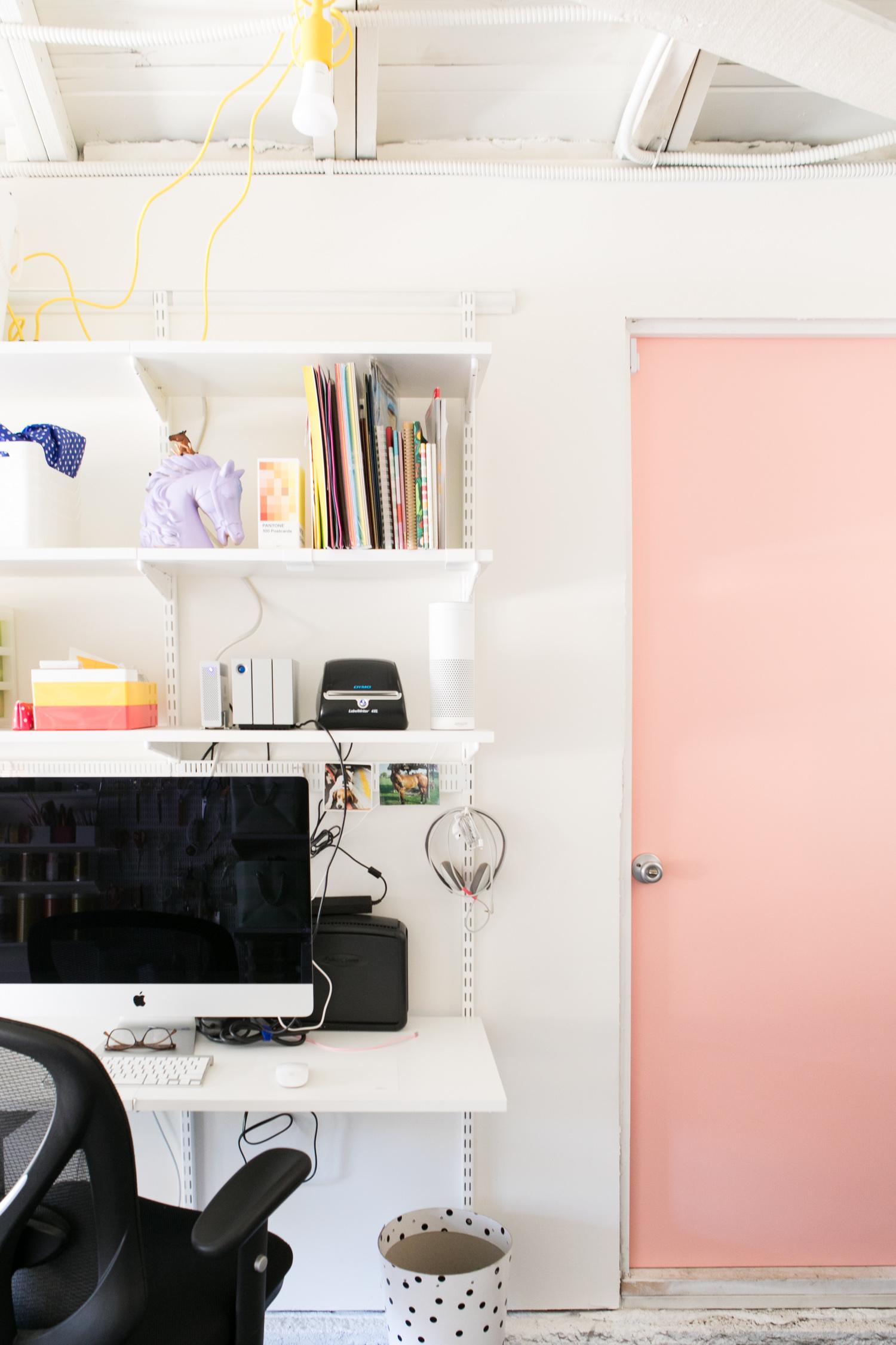 Pink office door and organized desk