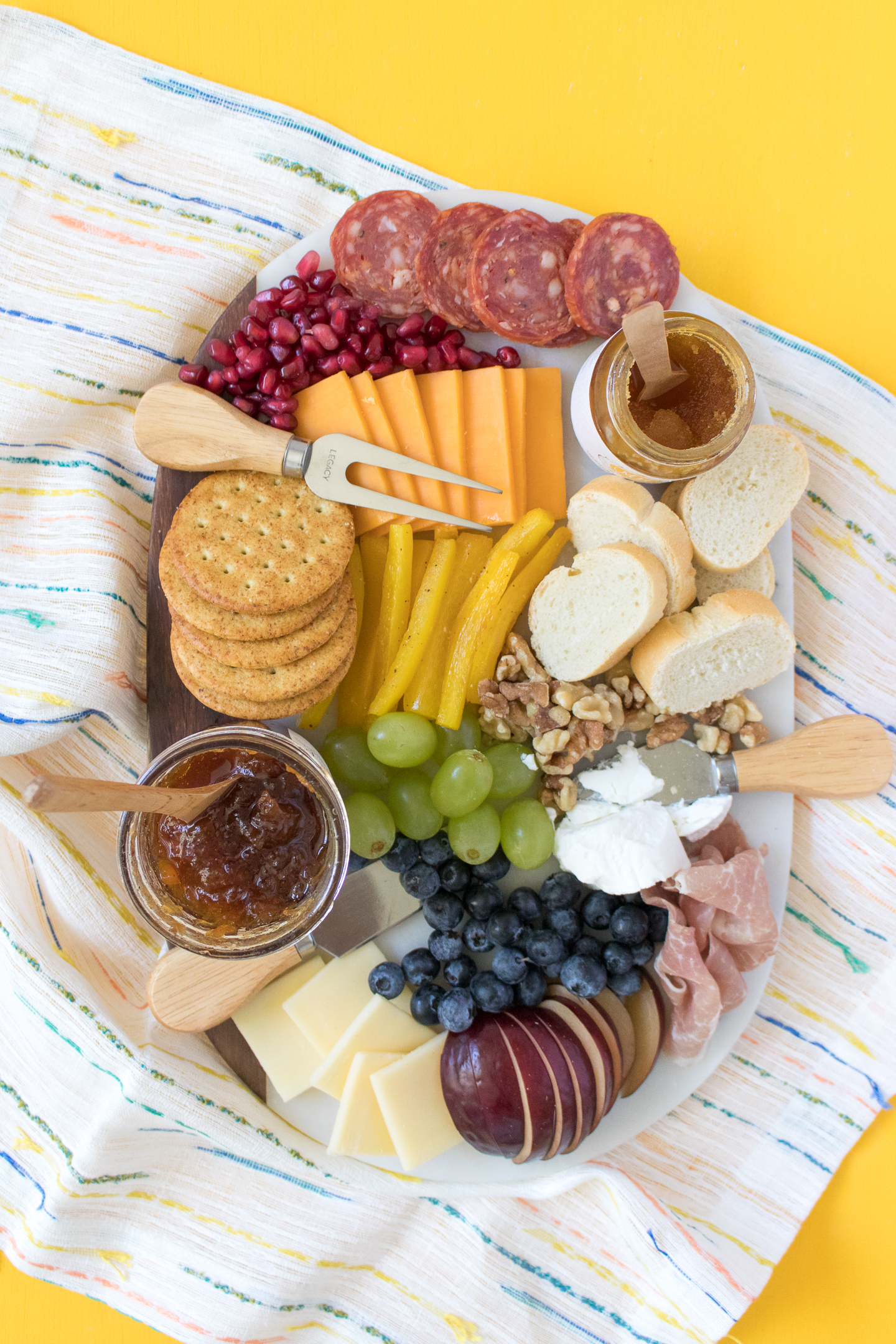 How to arrange a rainbow fruit and cheese board