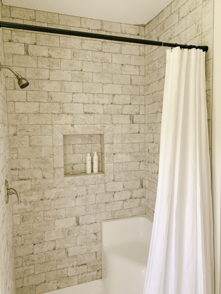 https sarahjanechristy com why we opted for a shower curtain instead of a glass door