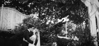 bride and groom kissing in the garden at The Inn on Peaks Island Portland Maine
