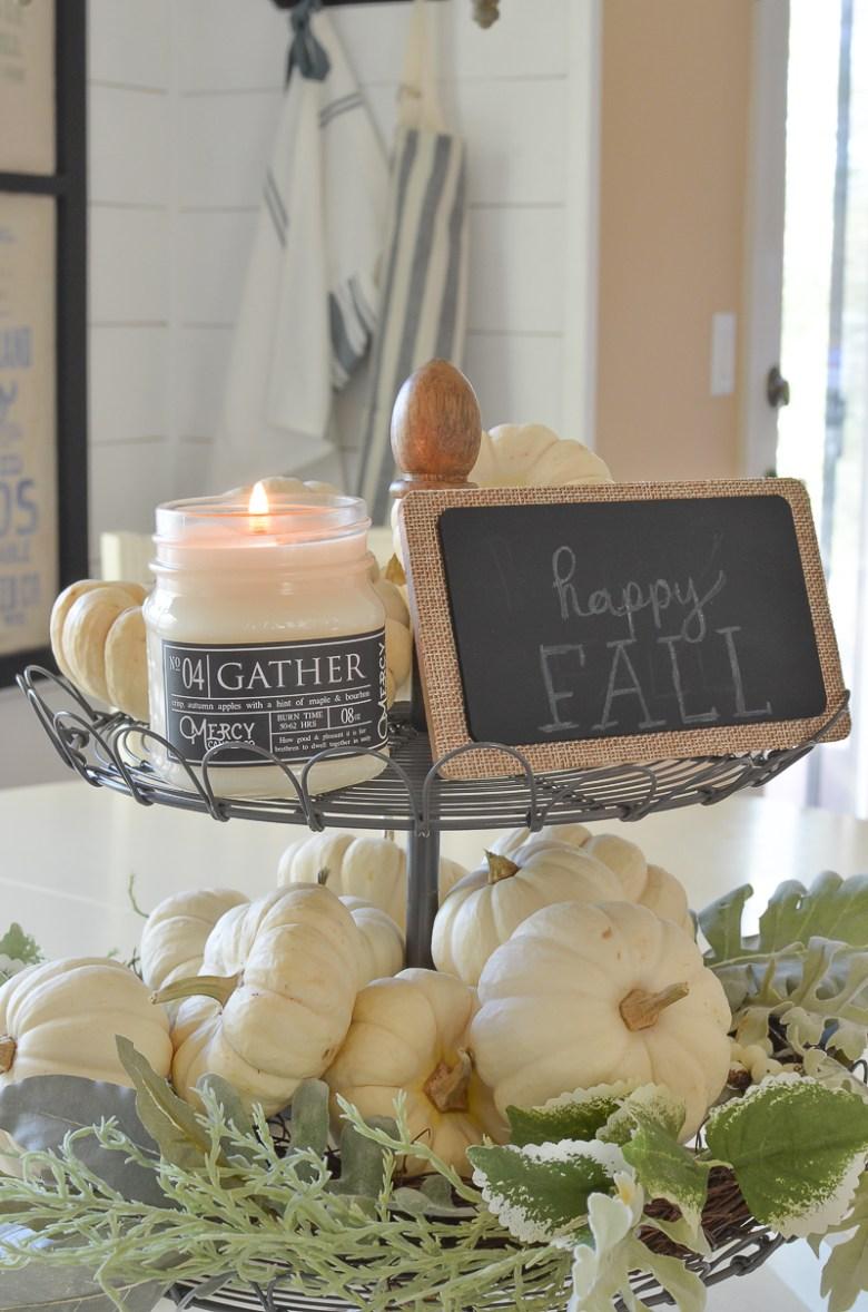 Farmhouse style decor. Tiered tray full of mini pumpkins for fall.