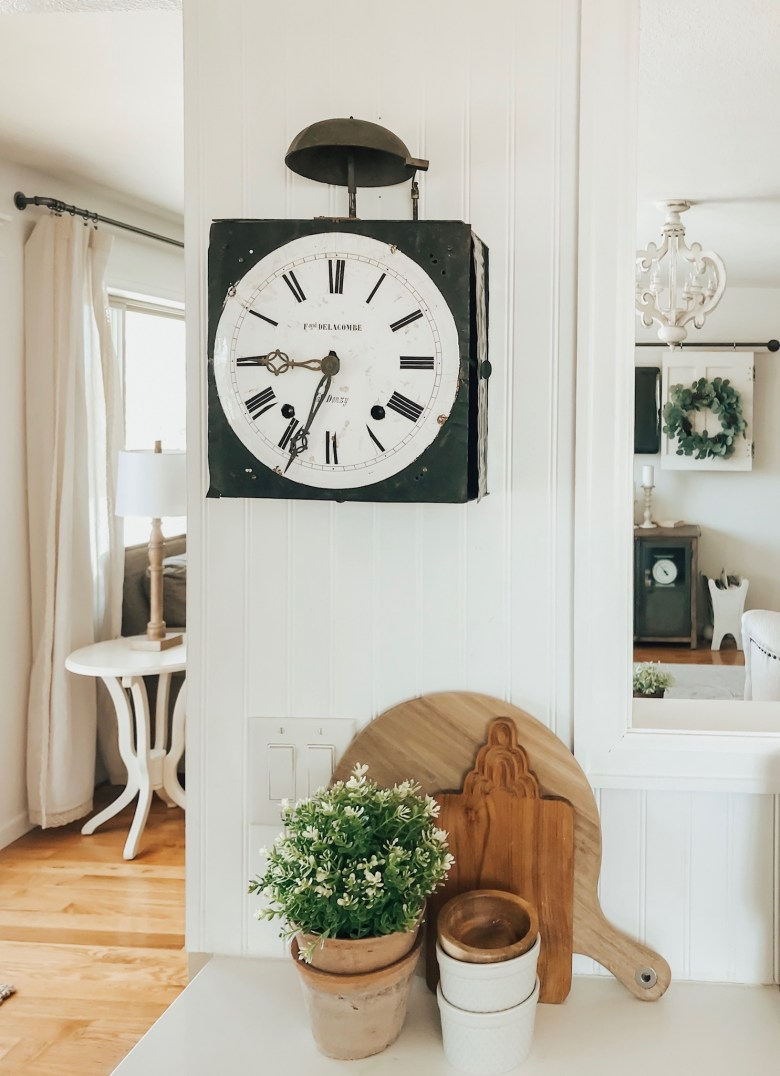 Vintage wall clock. Farmhouse style decor in the kitchen.