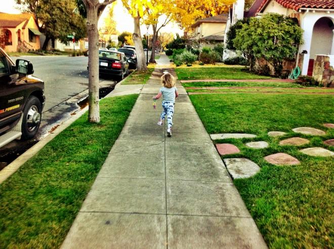 Running Down The Sidewalk, Christmas 2012 by Sarah Peck