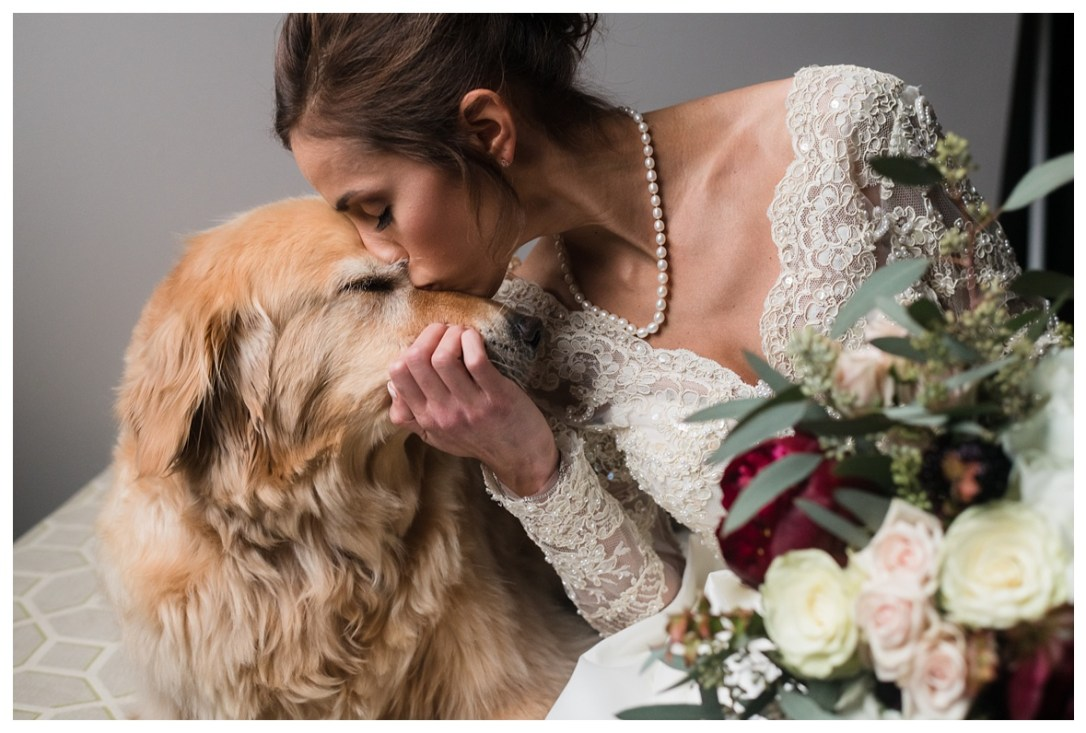 Chattanooga photographer who loves animals with bride kissing dog