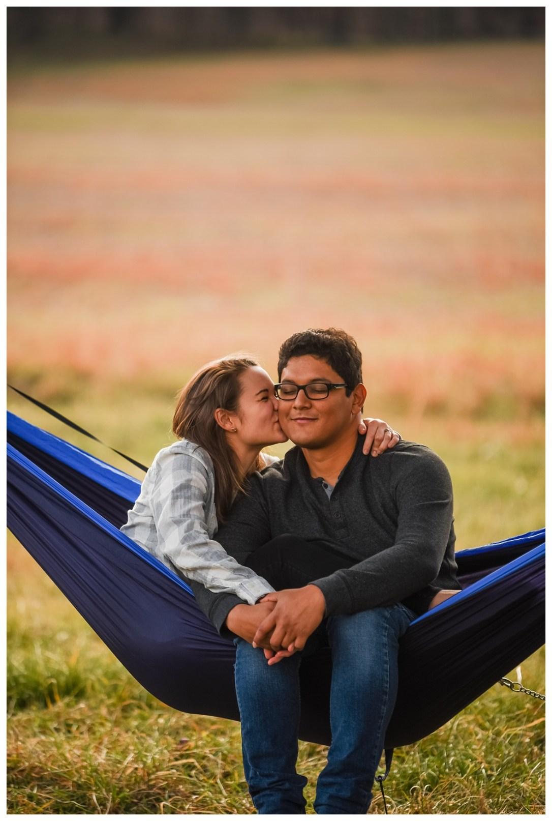 Couple snuggling in eno hammock
