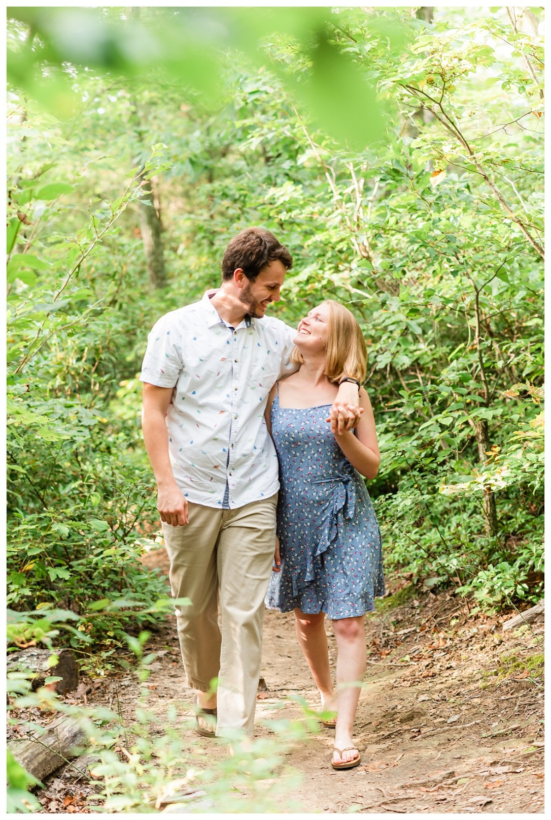 Engaged Couple walking through forest on signal mountain