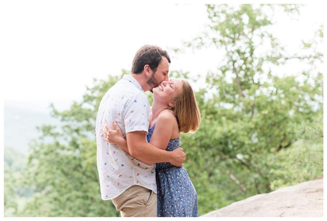 couple laughing at engagement session on signal mountain