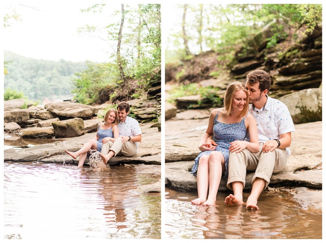 couple playing in water at falling falls