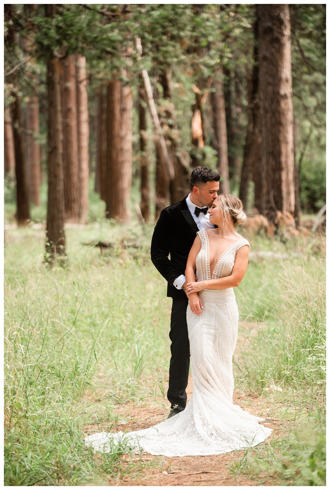 bride and groom walking through woods in Yosemite forrest