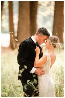 bride and groom walking through woods in Yosemite forrest