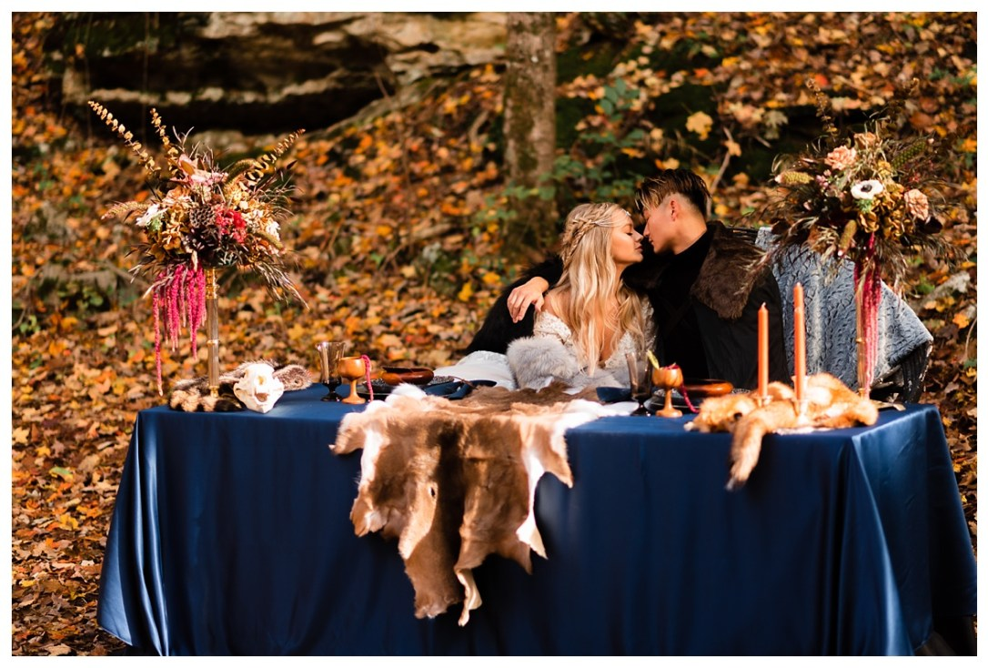 couple kissing at banquet table