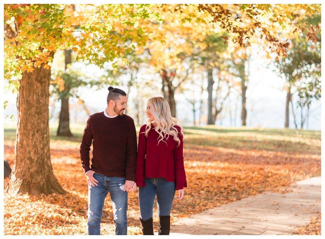 couple walking through point park in the fall