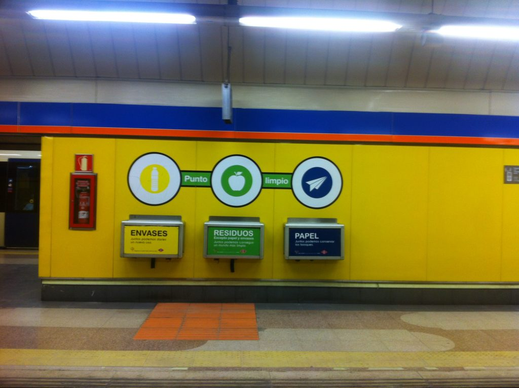 Recycling zone with three bins inside the Madrid metro