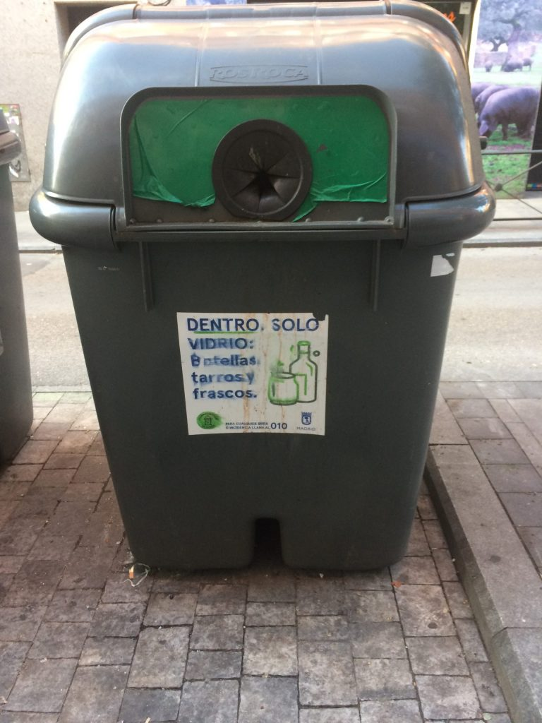 Gray and green bin for glass