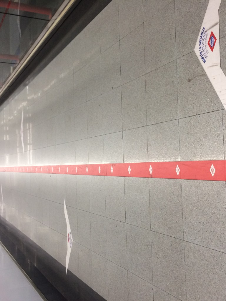 Hallway with divided lines inside Madrid metro network station