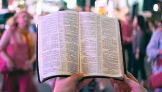person reading out of the bible