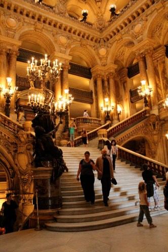 The Grand Staircase, Palais Garnier, Paris. Torchieres, gentle curves and balconies.