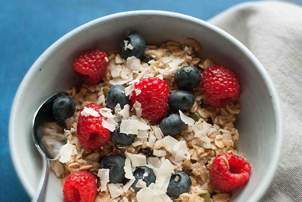 A bowl of granola with berries
